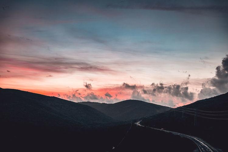 Landscape Sky Beauty In Nature Mountain Sunset Scenics - Nature Tranquil Scene Cloud - Sky Tranquility Environment Landscape Nature Mountain Range Transportation Non-urban Scene No People Orange Color Silhouette Idyllic Road Outdoors Mountain Peak