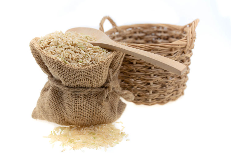 Close-up of wicker basket over white background