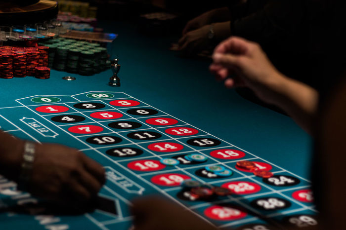 Addiction Atlantic City Betting Casino Colour Of Life Depth Of Field Gambling Hand Human Hand Lifestyle Multi Colored Roulette Roulette Table Selective Focus Unrecognizable Person