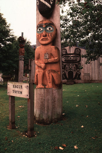 Wrangell Island, Alaska Alaska Art Buddha Carving - Craft Product Cemetery Close-up Creativity Day Eagle Totem Grass Memories No People Outdoors Sculpture Statue Tombstone Tree Wrangell