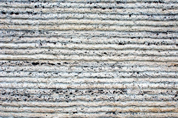 Striped concrete wall Stripes Architecture Building Building Exterior Built Structure Concrete Wall Copy Space Decoration Design Dirt Dirty Full Frame In A Row No People Pattern Rough Striped Structure Textured  Textured Effect