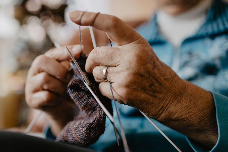 Skill  Knitting Creativity Knitting Needle One Person Human Hand Craft Art And Craft Holding Hand Human Body Part Wool Focus On Foreground Preparation  Indoors  Close-up Textile Adult Selective Focus Leisure Activity Sewing Needle Granny Grandma Stricken Knitting