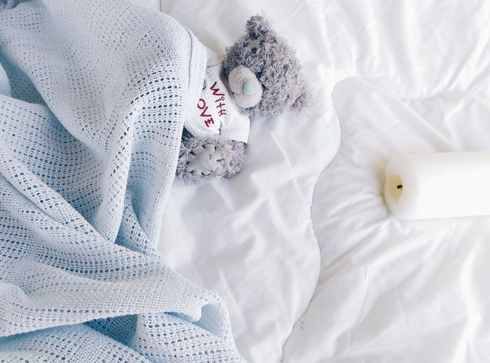 High angle view of soft toy in bed
