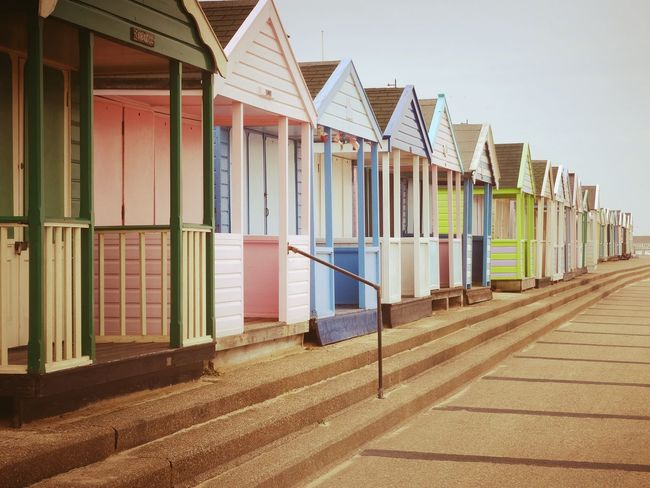 In A Row Beach Built Structure Multi Colored Architecture Sand Outdoors Day No People Sky Building Exterior Beach Huts Seaside Travel Retro Southwold Live For The Story