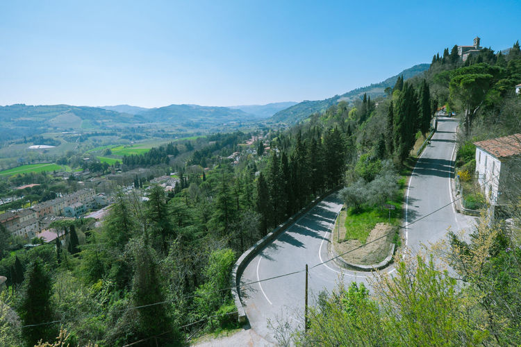 Hairpin bend on the way up to the hill Plant Tree High Angle View Nature Sky Road Mountain Architecture No People Day Built Structure Scenics - Nature Transportation Landscape Water Environment Beauty In Nature Mountain Range City Building Exterior Outdoors Hairpin Turns Bend
