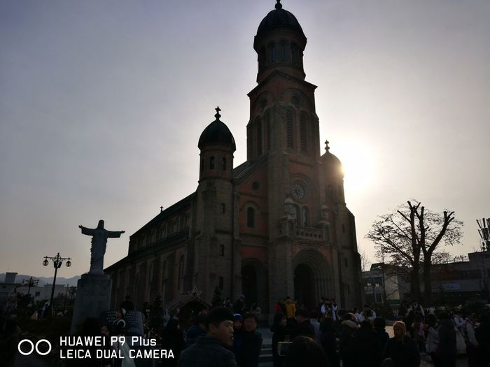 Adult Adults Only Architecture Building Exterior Built Structure City Cloud - Sky Crowd Day Jeondong Catholic Church Jeonju Korea Large Group Of People Low Angle View Men Outdoors People Place Of Worship Real People Religion Sky Spirituality Sunset Travel Destinations Women First Eyeem Photo