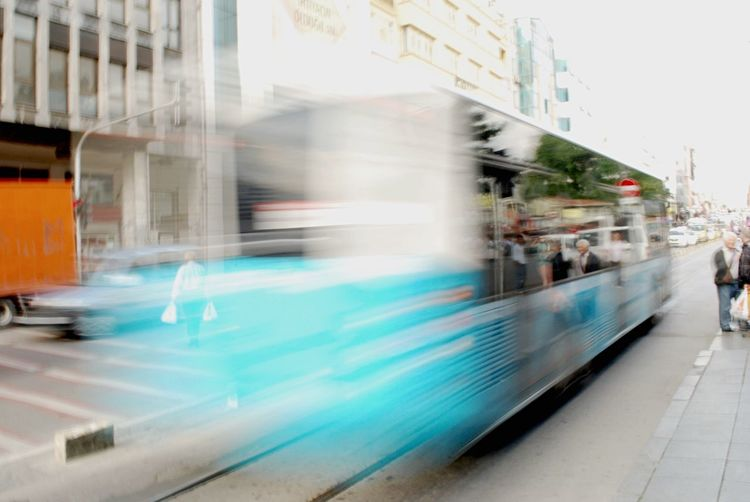 Blurred motion of cars on road