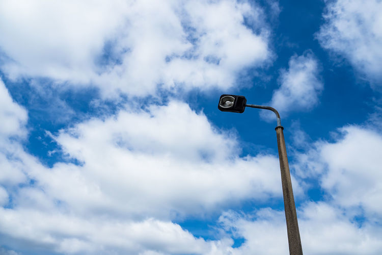 Lantern with blue sky. Lantern Blue Cloud - Sky Day Low Angle View No People Outdoors Skew Sky Street Light Technology