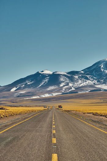 Mountain road Golden Grass Chile Travel Photography Mountain Clear Sky Snow Road Winding Road Cold Temperature Snowcapped Mountain Straight Blue Direction Mountain Road Desert Rocky Mountains