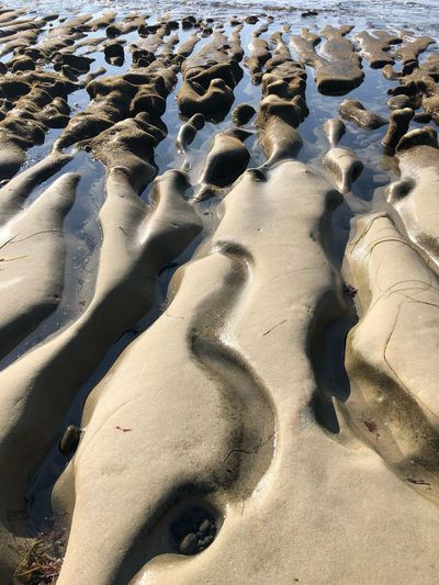 Water shapes stone Waves, Ocean, Nature Mesmerizing Backgrounds Beauty In Nature Reflection Sea Rocks Beach Coastline Sand Beach Land Nature Sunlight Day High Angle View