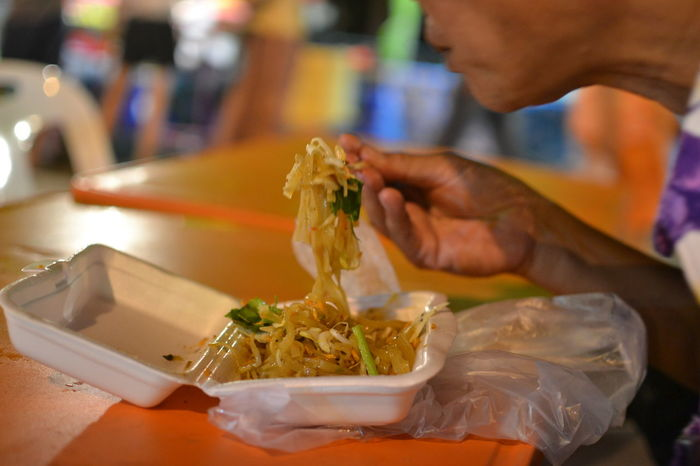 Thai Cuisine Close-up Eating Food Food And Drink Healthy Eating Holding Human Hand One Person Pad Thai Ready-to-eat Real People Street Food Table Thai Food Thai Street Food
