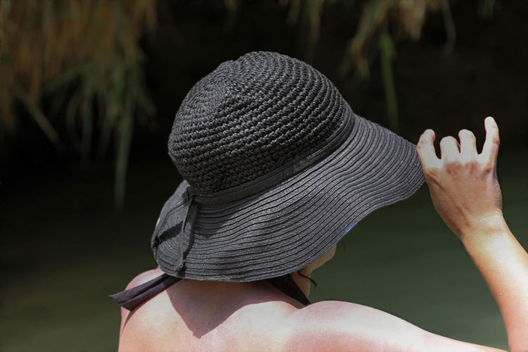 Rear View Of Woman Wearing Black Hat On Sunny Day