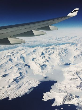 Aerial View Air Vehicle Aircraft Wing Airplane Cold Temperature Cropped Deep Blue Finnair Flying Glacier Greenland Journey Landscape Mid-air Mode Of Transport Mountain Mountain Range Part Of Pointy Scenics Snow Snowcapped Mountain Transportation Travel Winter