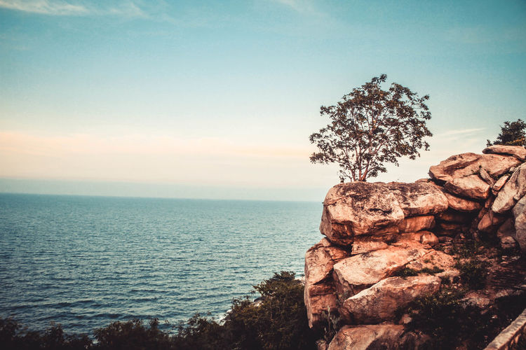 Sky Sea Beauty In Nature Rock Scenics - Nature Plant Outdoors Tree Nature Rock - Object Rock Formation Water Tranquility Tranquil Scene Horizon Over Water Horizon Solid No People Non-urban Scene Idyllic