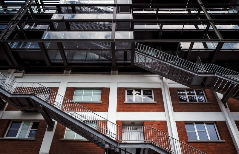 Urban Perspectives Street Photography Built Structure Architecture Building Exterior Window Building Low Angle View Residential District Railing Staircase Fire Escape Day No People Steps And Staircases Outdoors City Balcony Apartment Glass - Material House Architectural Detail The Devil's In The Detail Architectural Feature The Architect - 2019 EyeEm Awards My Best Photo