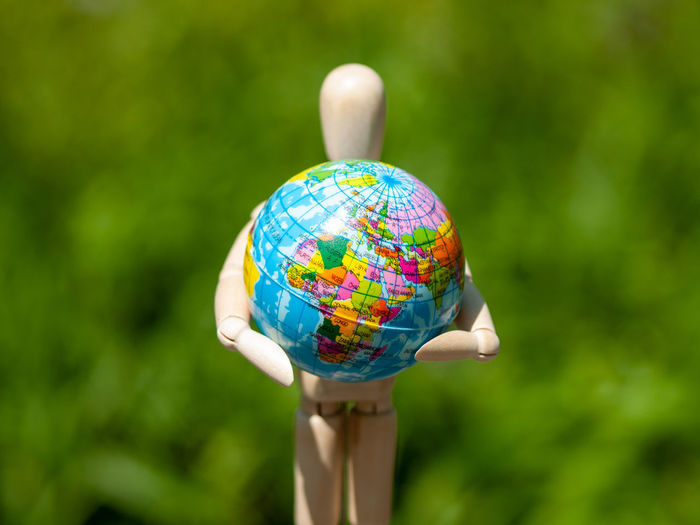 Close-up of figurine with globe