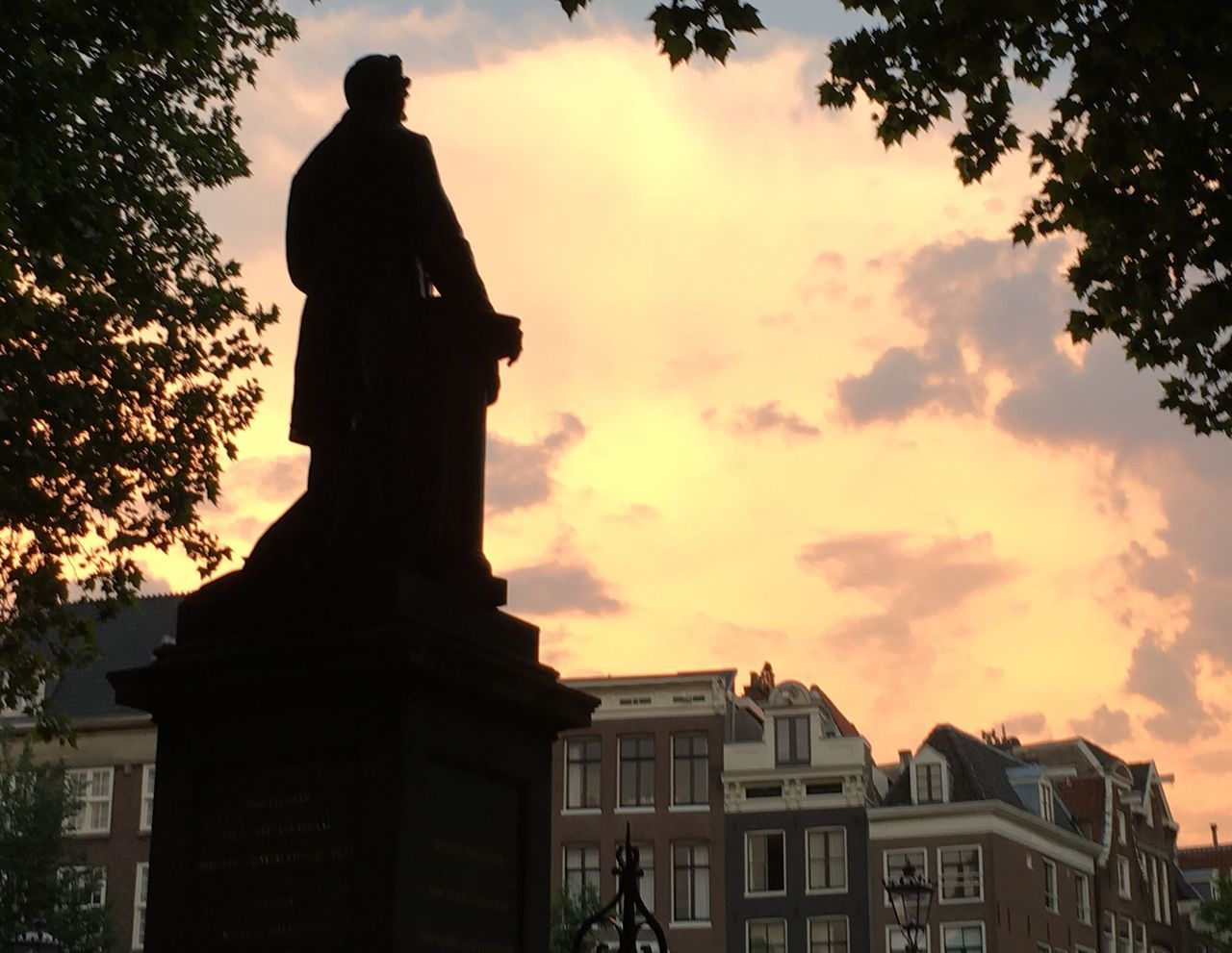STATUE AT SUNSET