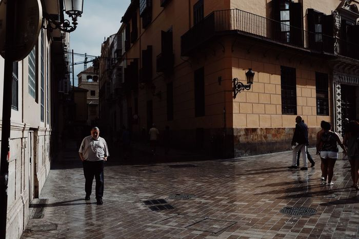 Just came back from a road trip though Andalusia/Spain. First stop: Malaga Creative Light and Shadow Travel Photography Building Exterior Built Structure Casual Clothing City City Life Day Fujifilm X-t20 Full Length Leisure Activity Lifestyles Outdoors People Standing Street Street Photography Streetphotography Travel Destinations Urban Landscape Urbanphotography Walking