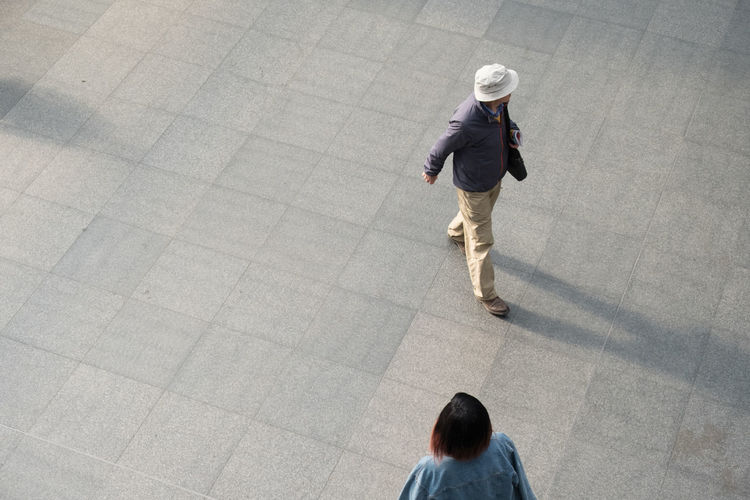 Man in a white hat and jacket and an Asian woman walk through a train station in Europe. Looking down on two people from above. Antwerp Antwerp Central Station Antwerp, Belgium Antwerpen Antwerpen Centraal Antwerpen, Belgium Adult Adults Only Antwerp Belgium Architecture Businessman Businesswoman Day Full Length High Angle View Indoors  Men People Real People Train Station Train Station Platform Train Stations Walking Well-dressed Young Adult