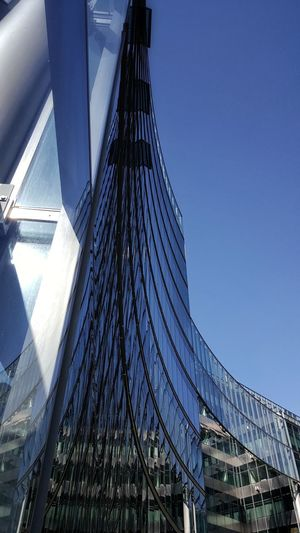 AntiM Architecture Modern Architecture Architecture Berliner Ansichten Blue Blue Sky Bridge - Man Made Structure Building Exterior Built Structure City Day Glass - Material Glass Windows With Reflections Low Angle View Modern No People Outdoors Potsdamer Platz Sky