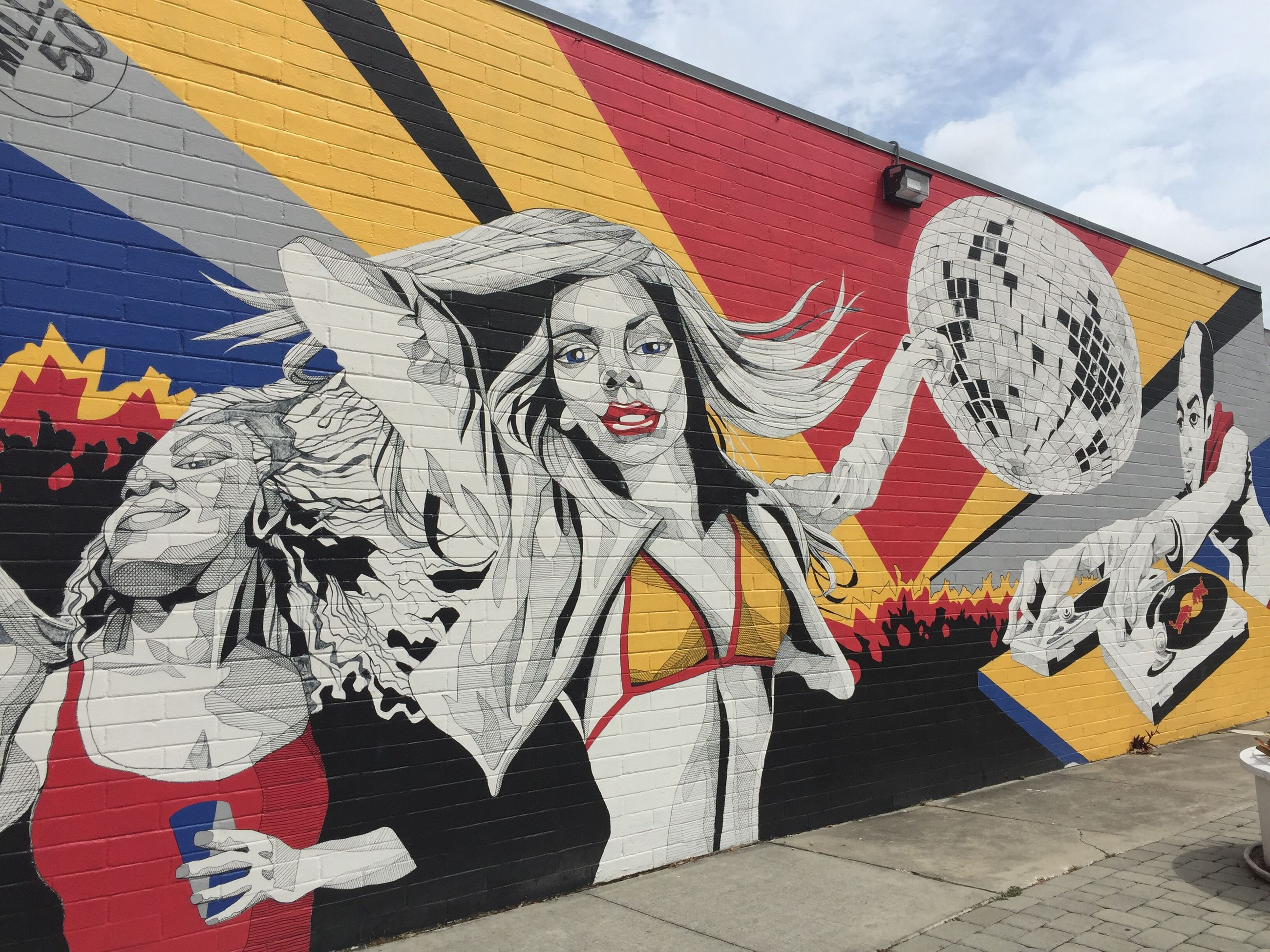 art and craft, art, creativity, graffiti, multi colored, built structure, human representation, architecture, wall - building feature, craft, design, street art, building exterior, fabric, day, pattern, animal representation, low angle view, textile