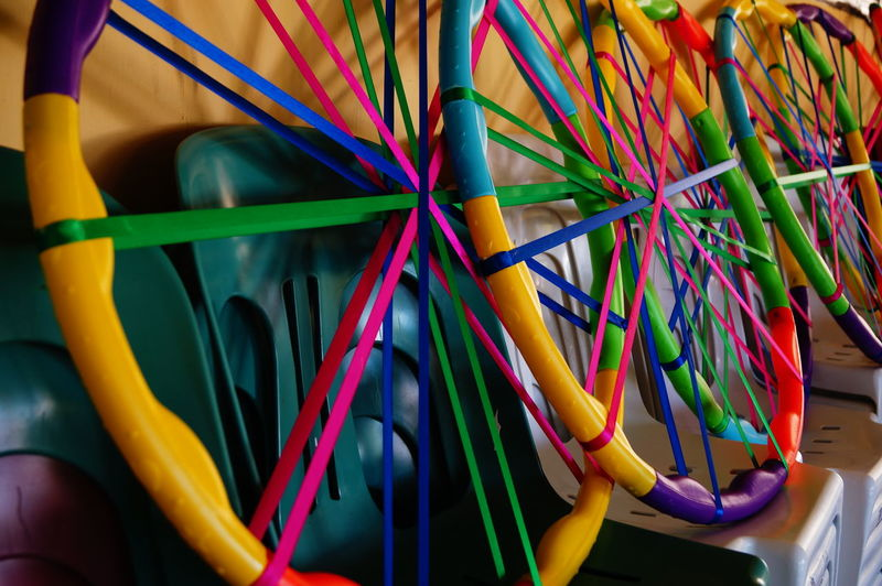 Multi Colored Ribbons Tied To Hula Hoops On Chairs