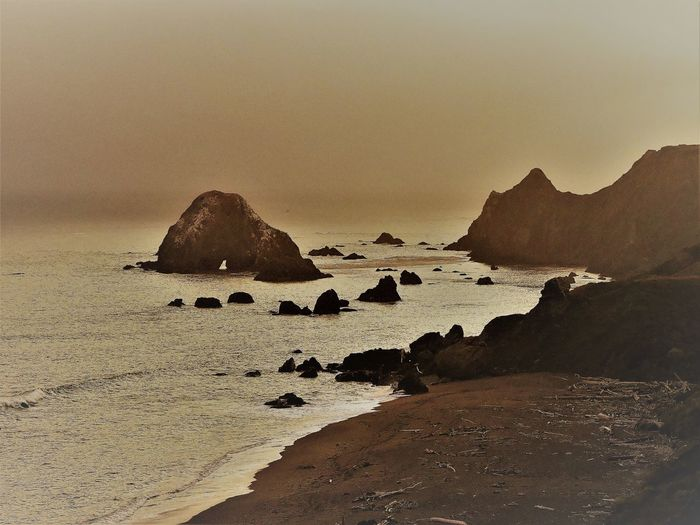 Sonoma County CA Beach Beauty In Nature Copy Space Driftwood Beach Headland Idyllic Land Nature No People Outdoors Rock Rock - Object Rock Formation Scenics - Nature Sea Sky Solid Sonoma County Coast Stack Rock Sunset Tranquil Scene Tranquility Water