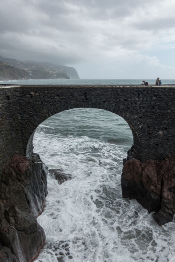 View of Ponta do Sol pier bridge in Madeira Architecture Autumn Cloudy Coastline Madeira Nature Panorama Panoramic Portugal Portuguese Travel Aerial View Arch Bridge Coast Horizon Island Landscape Outdoors Ponta Do Sol Rocks Sea Seascape Water Waves