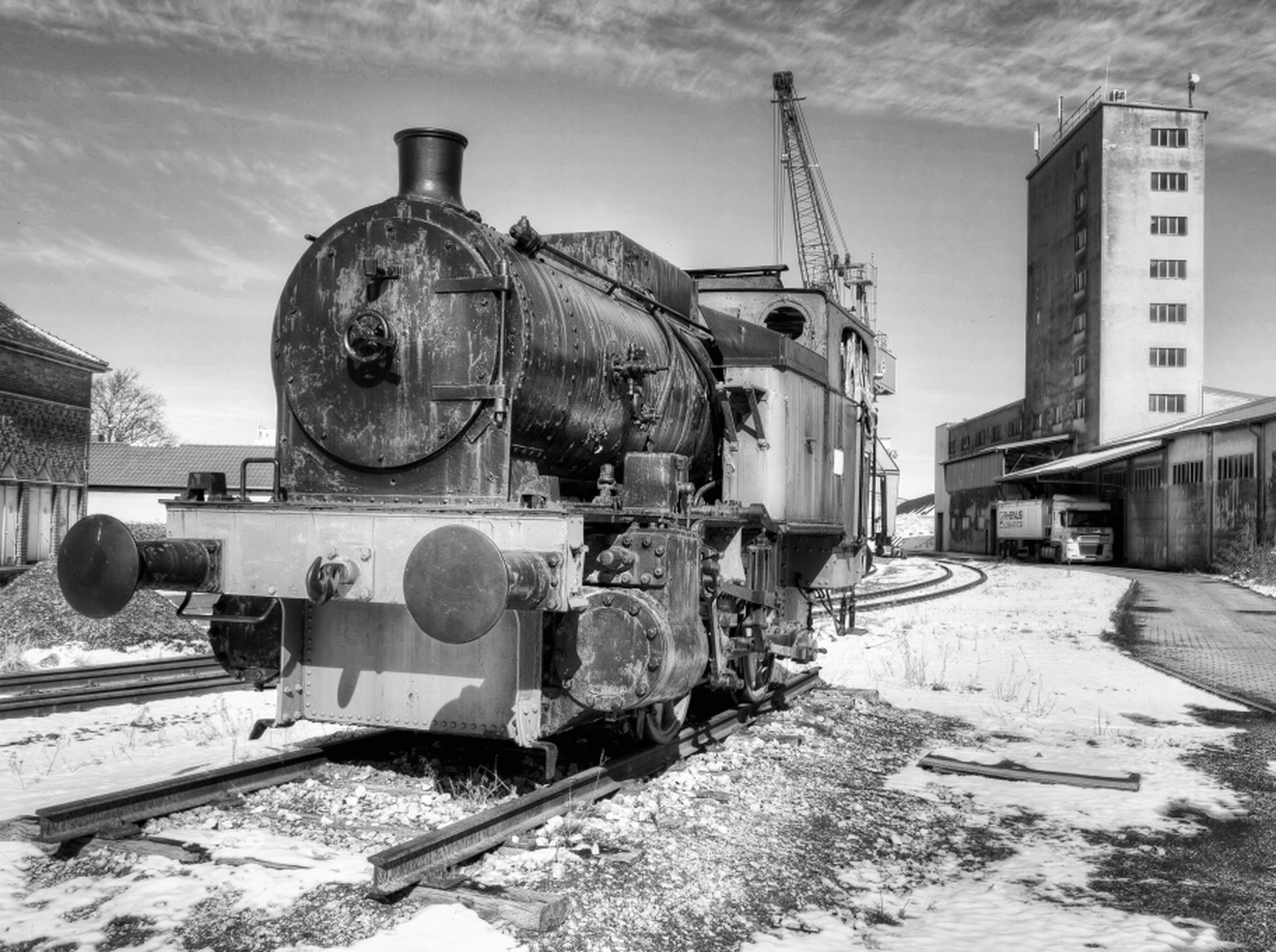 transportation, railroad track, built structure, building exterior, architecture, mode of transport, public transportation, rail transportation, train - vehicle, sky, industry, day, factory, outdoors, machinery, fuel and power generation, no people, metal, technology, land vehicle