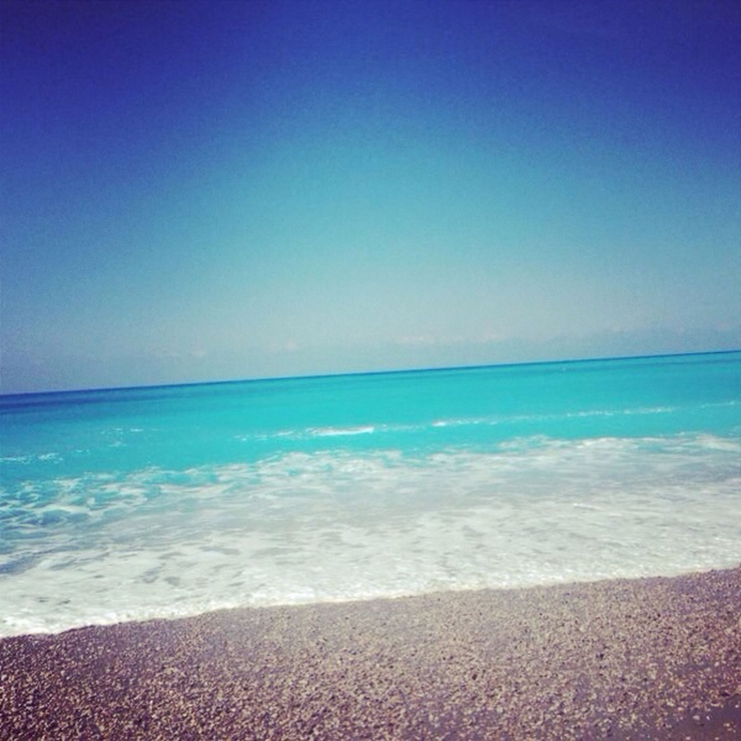 sea, water, beach, horizon over water, blue, shore, scenics, tranquil scene, beauty in nature, clear sky, tranquility, copy space, sand, wave, nature, surf, idyllic, sky, coastline, seascape