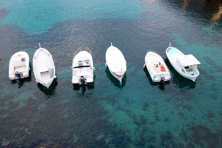 Boats moored on calm  shallow water