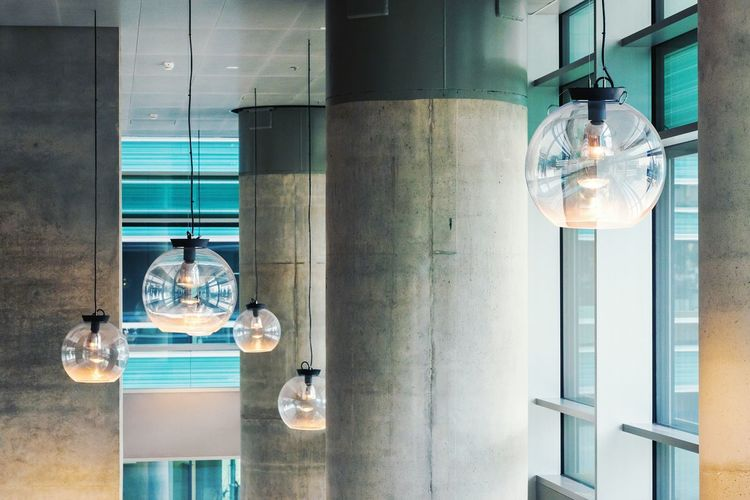 Illuminated Pendant Lights Hanging In Office