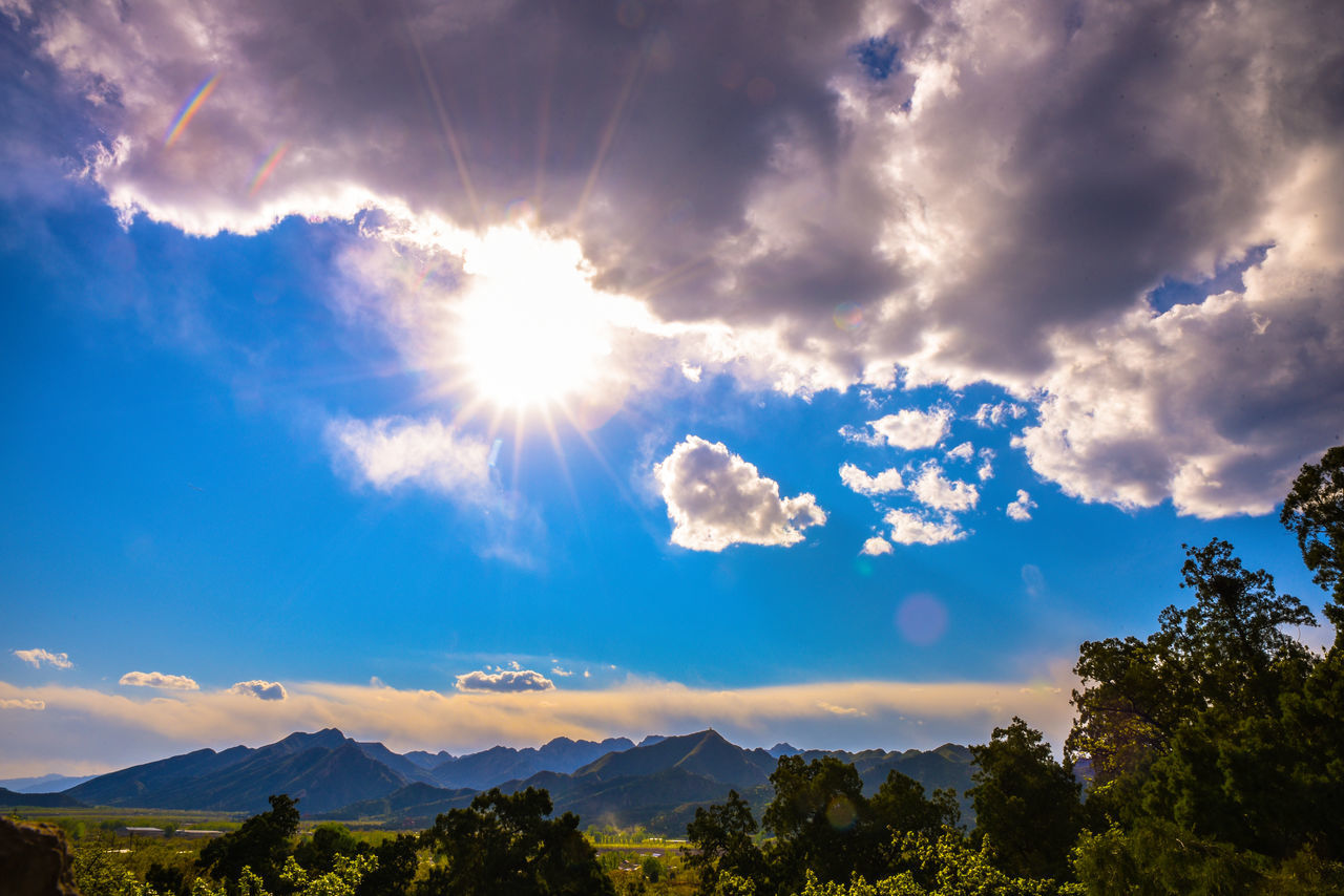 sky, cloud - sky, nature, beauty in nature, scenics, sunbeam, tranquility, sunlight, sun, idyllic, tranquil scene, outdoors, no people, mountain, low angle view, day, tree