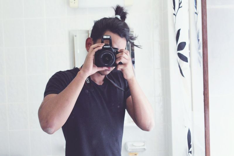 Photography Themes Camera - Photographic Equipment One Man Only Photographing Adults Only Waist Up Only Men Photographer Adult Bathroom One Person Domestic Bathroom Indoors  Front View Standing Young Adult Portrait People One Young Man Only Looking At Camera Beginnerphotographer