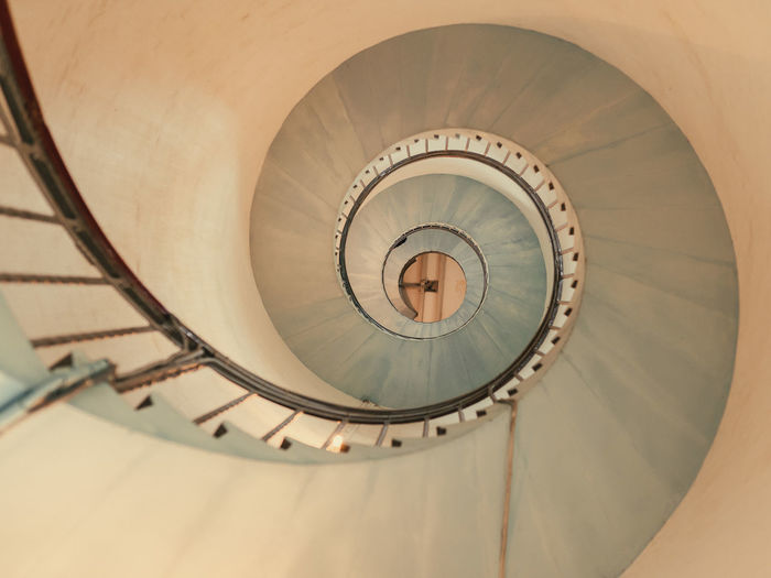 Low angle view of spiral staircase in lighthouse building