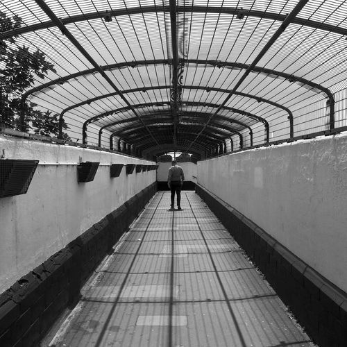Street Photography Man Symmetry Symmetrical Shadow Full Length Shadow Architecture Footbridge Covered Bridge Bridge Elevated Walkway Pathway Bridge - Man Made Structure