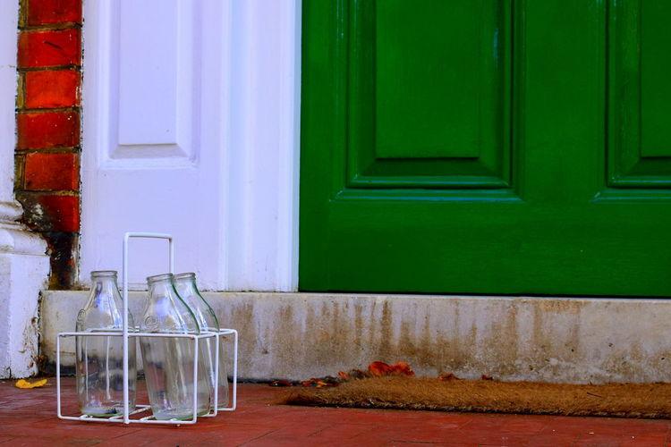 Empty milk bottles in container