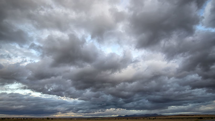 Scenic view of dramatic sky over storm clouds