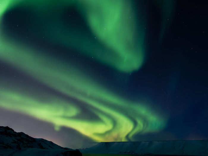 Night Beauty In Nature Green Color Scenics - Nature Space Sky Astronomy Star - Space Snow Winter Dramatic Sky Tranquil Scene Cold Temperature Tranquility No People Natural Phenomenon Environment Idyllic Aurora Polaris Power In Nature Luminosity