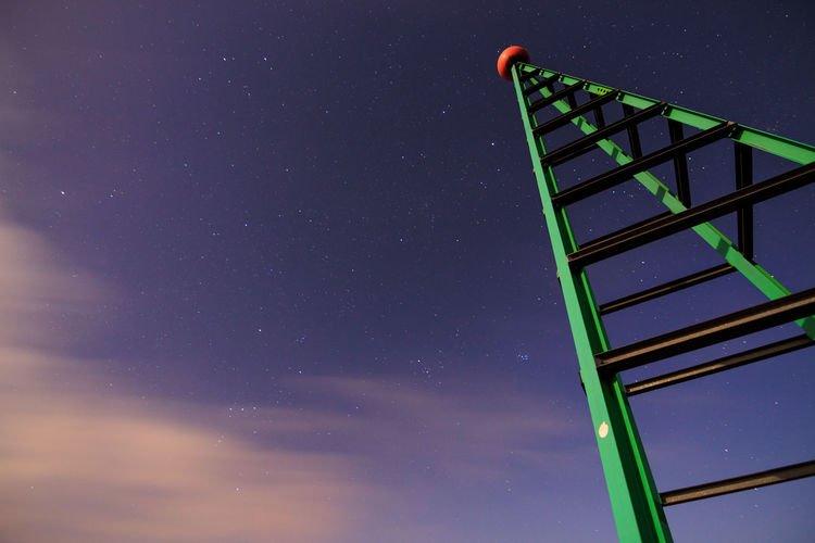 Low Angle View Of Tower Against Night Sky