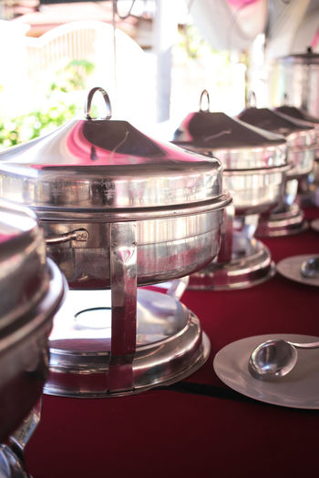 Close-up of containers arranged on table during wedding