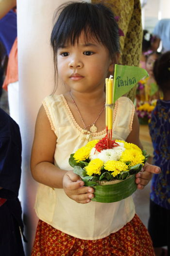 Close-up of girl holding flowers