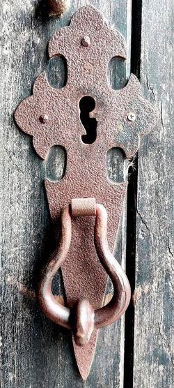 Close-up of heart shape on metal door