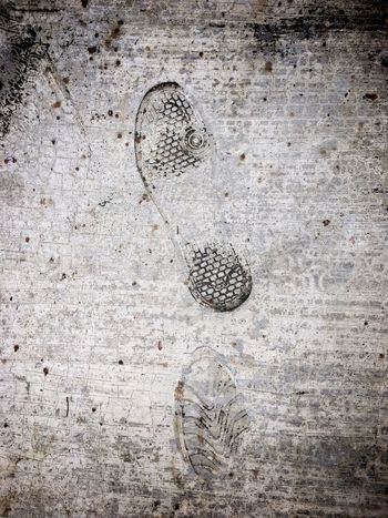 A couple of shoeprints impressed on dirty pavement .. Shoeprints Pattern Impressed Imprint Footprints No Hurry Pavement Sidewalk Footpath Dirt Dirty Textured  Surfaces And Textures Lasting Impression Couple Two No People Bad Day Gloomy Day Outdoors Color Image