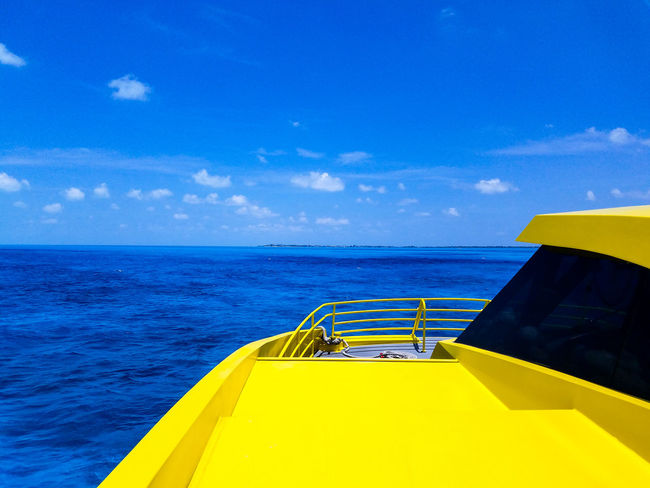 Yellow No People Blue Water Sky Day Outdoors Horizon Over Water Nature Clouds Vacation May 2017 Spring Springtime Cancun MexicoBeauty In Nature Boat Clear Clear Water Tropical Trapical Climate Scenics Cloud - Sky Isla Mujeres Mexico The Week On EyeEm