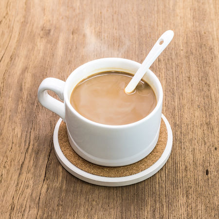 Coffee mug and beverage coaster on wooden background. Beverage Beverages Coasters Drinks Background Coaster Coffee Coffee - Drink Coffee Cup Crockery Cup Cups Drink Eating Utensil Food And Drink Freshness Kitchen Utensil Mug Mugs Pad Refreshment Spoon Still Life Table Wood - Material