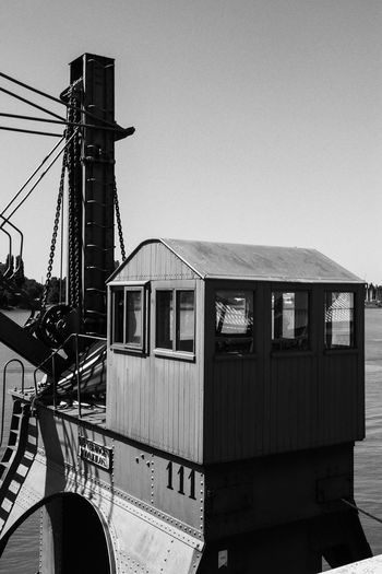 The abandoned crane house of the old harbor crane Harbor Logistics Old Machines Abandoned Technology Architecture Black And White Built Structure Clear Sky Crane Crane House Day Historic Machines Low Angle View Mode Of Transport No People Outdoors Rail Transportation Sky Train - Vehicle Transportation The Week On EyeEm