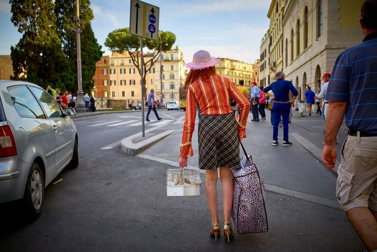 A new beginning. Rear View Dressed Up Hat Woman Italy Rome Leicacamera ELMARIT-M 28mm F2.8 EyeEmNewHere LEICA M Leica Street Photography Streetphotography Birdcage A New Beginning City Architecture Street Real People Building Exterior A New Beginning EyeEmNewHere