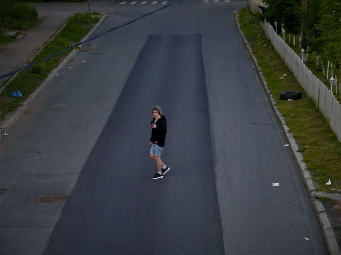 High angle view of man skateboarding on road