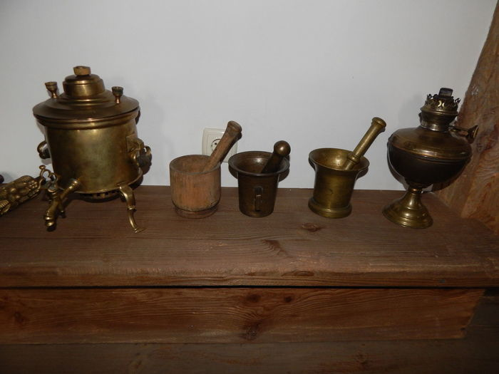 Close-up of old objects on table against wall